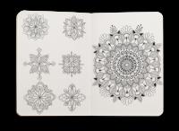 Skissebok med ornament skisser
